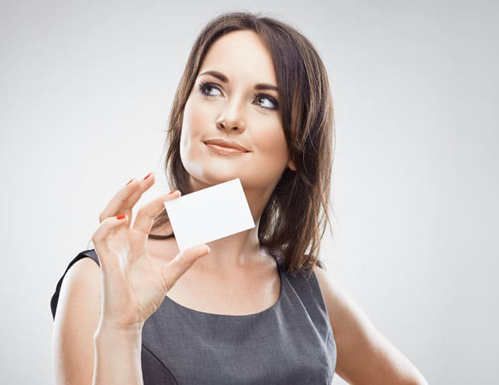 Happy business woman hold credit card. Isolated white background.